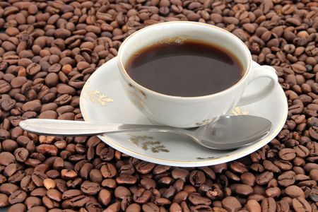 Cup of coffee on coffee bean background Stock Photo