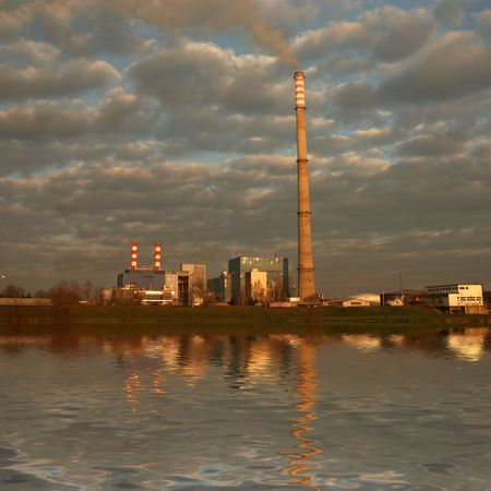 evaporating: Powerplant with cloudy sky and reflection in river Stock Photo