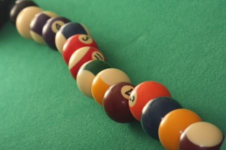 poolball: Raw of pool balls on green background