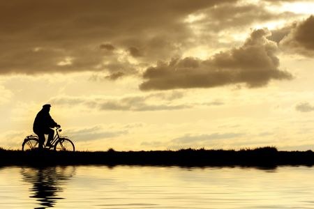 Silhouette of man on bicycle
