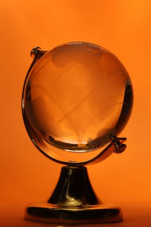 Glass globe on red background Stock Photo