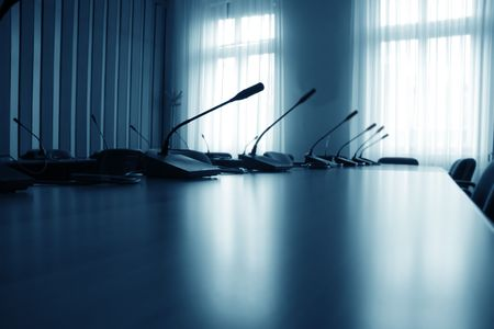 Close up of empty boardroom meeting area with blue light on