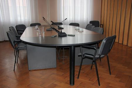 Empty boardroom meeting area with wooden floor after meeting Stock Photo - 3444660