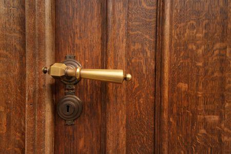 Golden door knob on wooden door Stock Photo