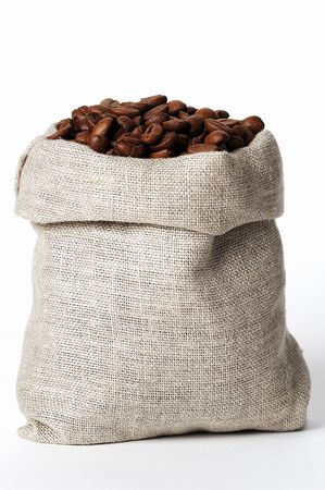 small bag of coffee on white-grey background with clipping path photo