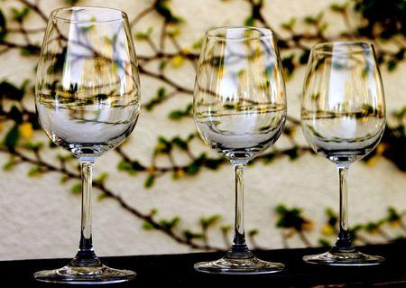 Three Wine Glasses sitting on a ledge photo