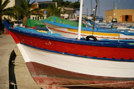 Colorful boats lining the beach in italy