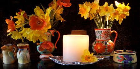 Candle and Vases filled with dafodils