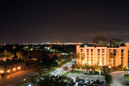Tampa FL night skyline, west side of city looking East towards airport in center of image. Stock Photo