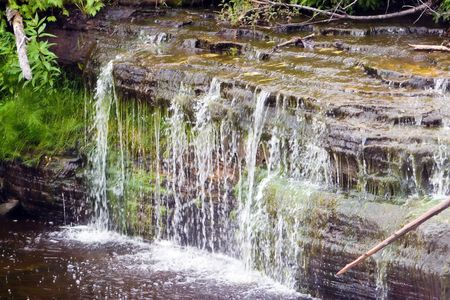 Water flowing over Lower Tahquamenon falls in Paradise, MI photo