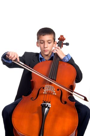 Young boy student practicing playing musical instrument Cello photo