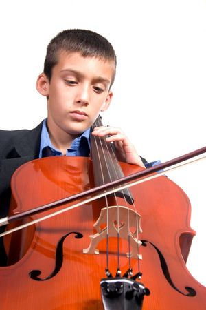 Young boy student practicing playing musical instrument Cello