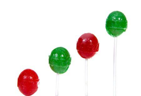 arranged: Lollipops arranged in rising row Stock Photo