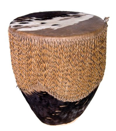 rawhide: Small rawhide Indian drum shot over white.   Stock Photo