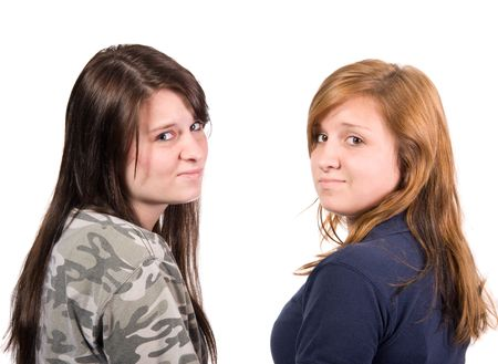 over the shoulder: Two teenage girls looking over shoulder with an attitude