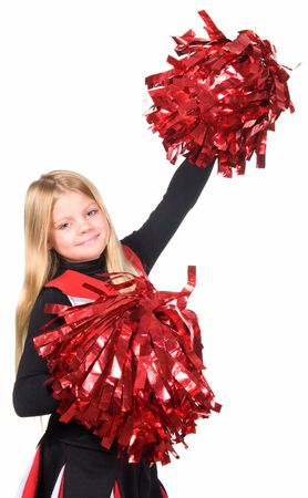 Young cheerleader with red pom-poms smiling at camera isolated over white background.