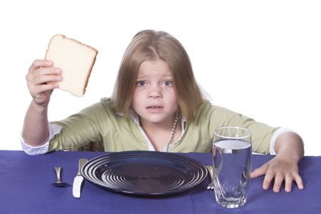 Young girl in disbelief about her bread and water dinner. photo