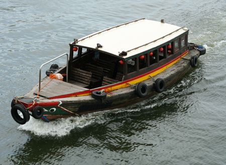 A bumboat travel along a river looking for passengers. Stock Photo