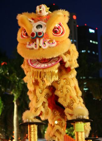 Lion dance troupe performance during chinese new year. Stock Photo