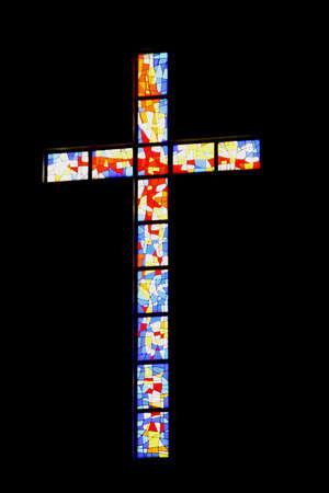 A colourful cross in a church