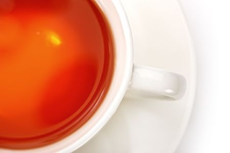 Close-up view of a delicious cup of black tea on a white table