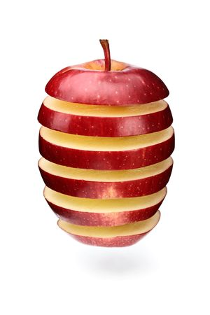 A red apple sliced in layers and arranged with gaps photo