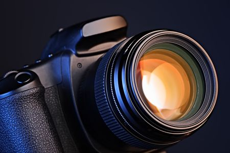Close-up of a camera with a lens  Stock Photo