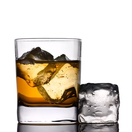 icecube: A drink on the rocks with ice-cube Stock Photo