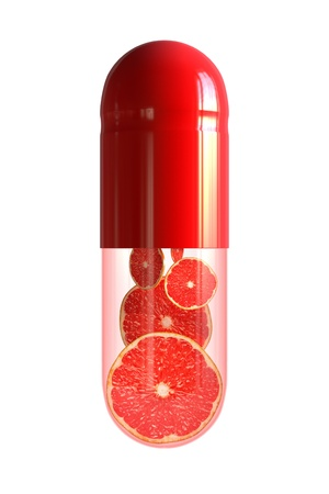 nutritional supplement: Capsule with citrus fruit - isolated on white