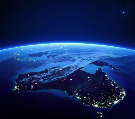 ocean view: Australia with city lights from space at night - Earth daytime series  Stock Photo