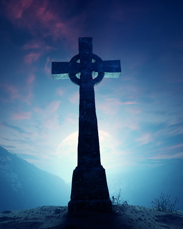 celtic cross: Celtic Cross with moonscape on crest of rocky mountain Stock Photo