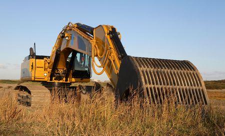 excavate: Yellow excavator