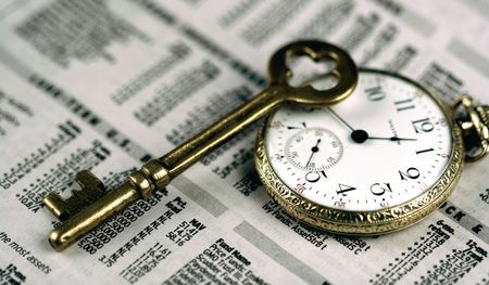 timing the market: Pocket Watch, Skeleton Key, And Business Section Of Newspaper Stock Photo