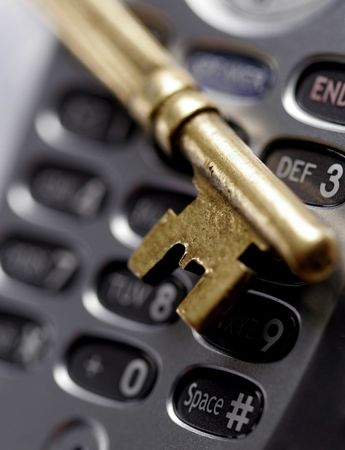 atop: An old brass key atop a cell phone