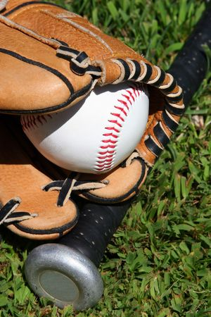 outfield: Glove, bat, and ball on grass Stock Photo