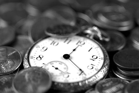 monies: Time And Money Concept - Old pocketwatch and US Coins