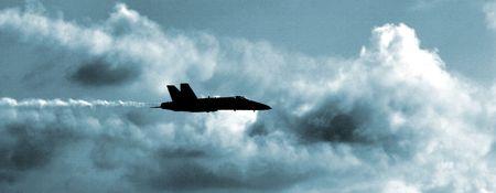 jet fighter: A single US Navy FA18 Blue Angel Hornet on patrol in steel blue skies