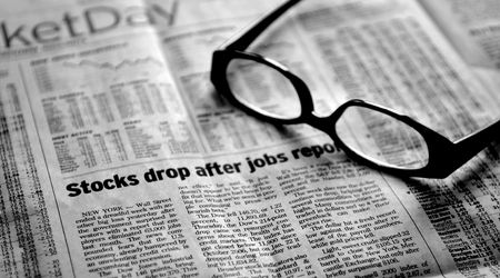 Analysis in a down market - stagflation - Newspaper and glasses photo
