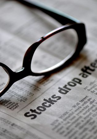Market Analysis in a down Market - Newspaper and glasses over stocks drop photo