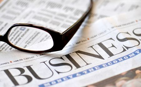 Business section of the newspaper and glasses Stock Photo - 2671036