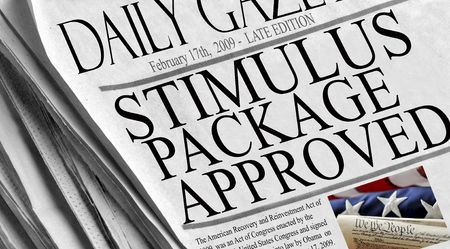 current events: Stock Photo of Stimulus Package Approved - newspaper headlines document the signing by President Barack Obama of the American recovery and reinvestment act on February 17th, 2009.