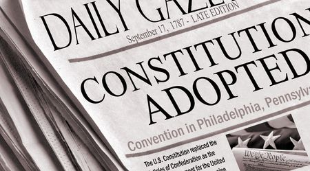 adopted: On September 17, 1787 The Constitution Of The United States was adopted. This is a newspaper recreation of the event. Small image also by photographer. Sepia colors.