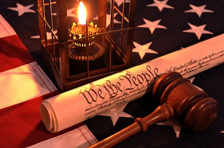 hurricane lamp: We The People - hurricane lamp, wooden gavel, Constitution document and US flag.