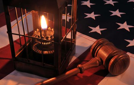 hurricane lamp: We The People - hurricane lamp, wooden gavel and US flag. Stock Photo
