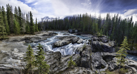 unincorporated: Natural Bridge, just outside of the city of Field. Field is an unincorporated community of approximately 169 people located in the Kicking Horse River valley of southeastern British Columbia, Canada, within the confines of Yoho National Park. Stock Photo
