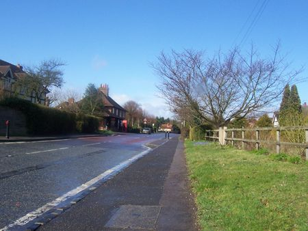 english village: a main road going through a english village Stock Photo