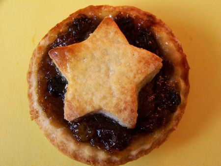 mince pie: macro shot of a home made mince pie on yellow background