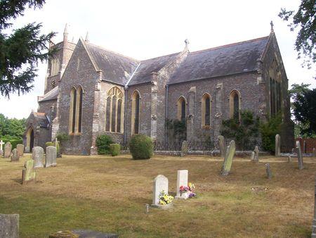 churchyard: a english church and churchyard in summer  Stock Photo