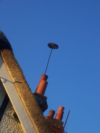 poking: a brush poking out the chimney after it has been swept!!