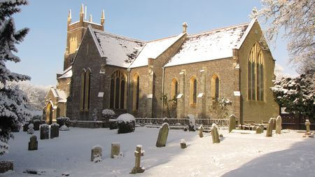 An English church and churchyard covered in snow Stock Photo - 6679923